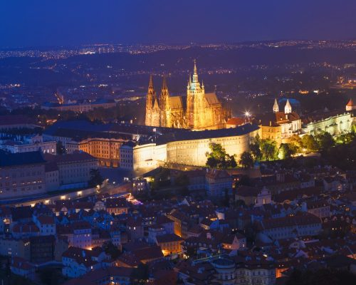 Prague, Czech Republic. Night View Of Prague Castle, St. Vitus Cathedral. Lesser Town, Prague Castle In Night Lighting Illumination. Famous Landmark, UNESCO World Heritage.