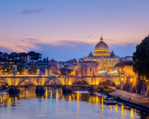 Famous citiscape view of St Peters basilica in Rome at sunset, Italy